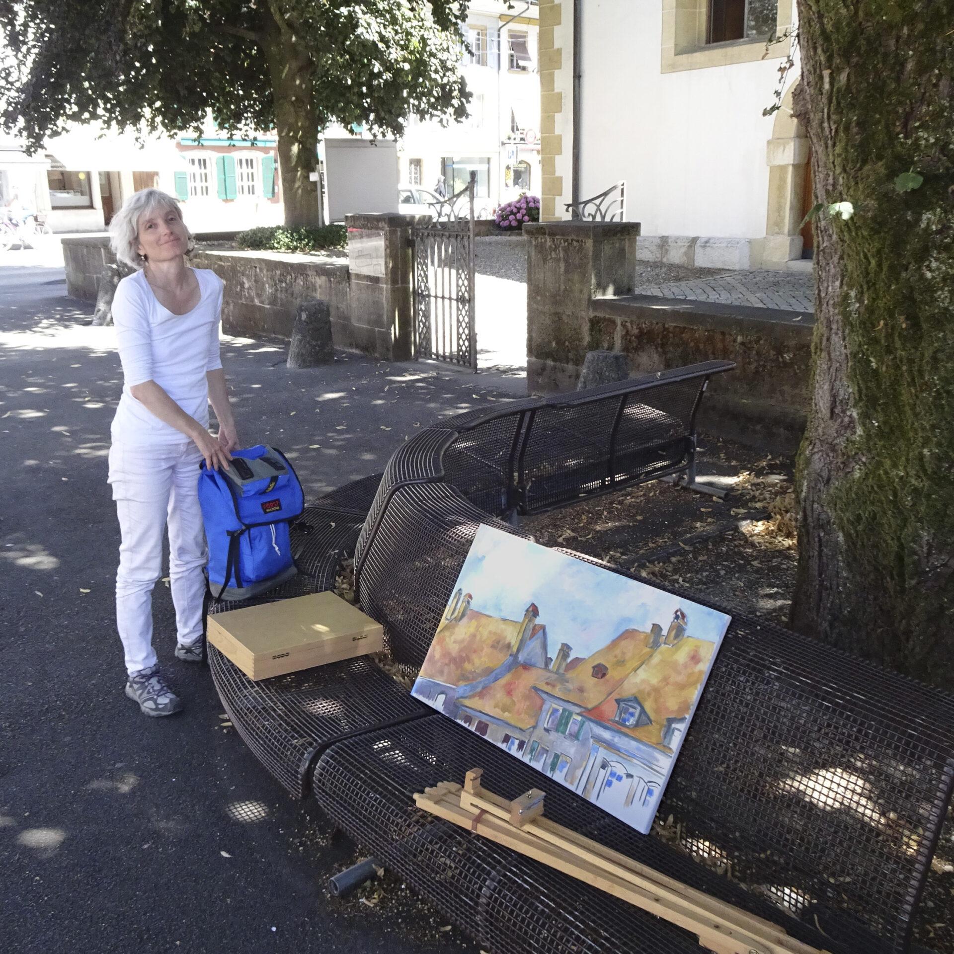 Malerin mit Dächerlandschaft